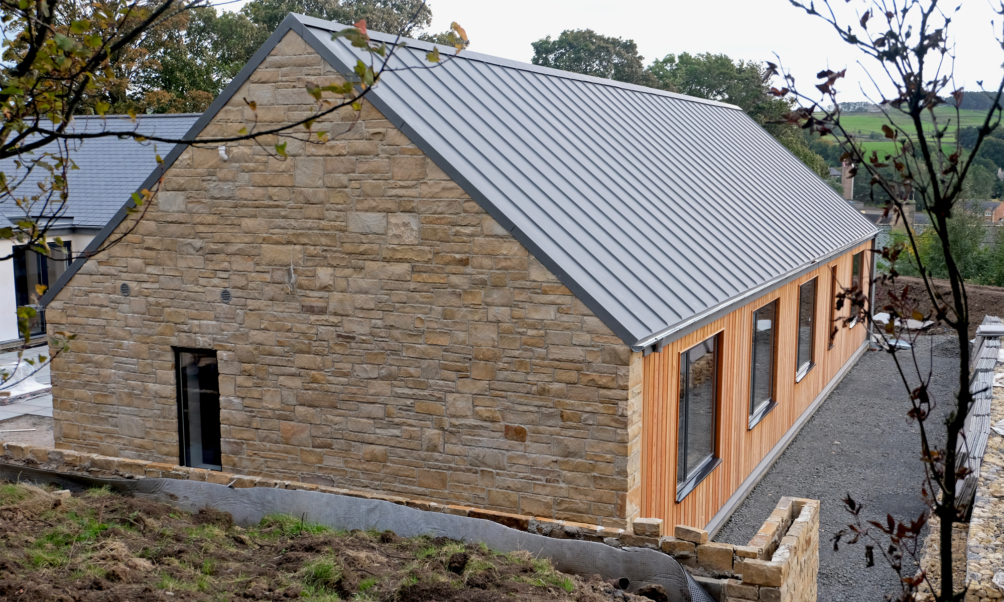 Hopedene House Wood Cladding with Zinc